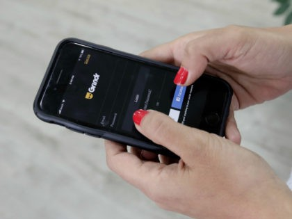 In this Wednesday, May 29, 2019 file photo, a woman checks the Grindr app on her mobile phone in Beirut, Lebanon. Dating apps including Grindr, OkCupid and Tinder leak personal information to advertising tech companies in possible violation of European data privacy laws, a Norwegian consumer group said in a …