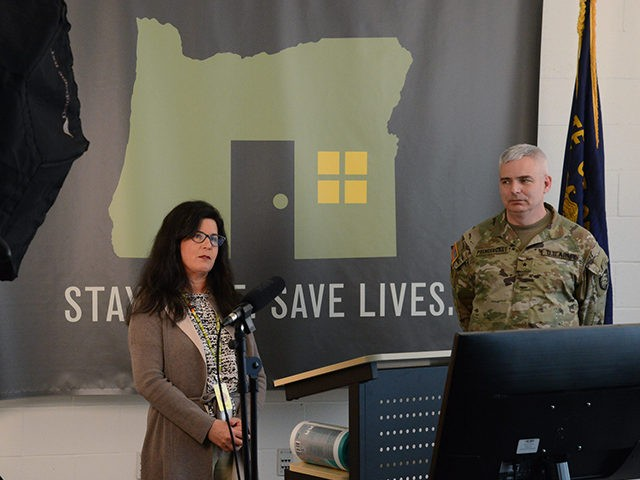 Akiko Saito with the Oregon Health Authority (OHA) and Brig. Gen. William J. Prendergast, IV, Commander, Land Component Command, Oregon Army National Guard lead the first of many new daily web briefings, April 28, 2020 at the Department of Public Safety Standards and Training, Salem, Ore. The Oregon National Guard …