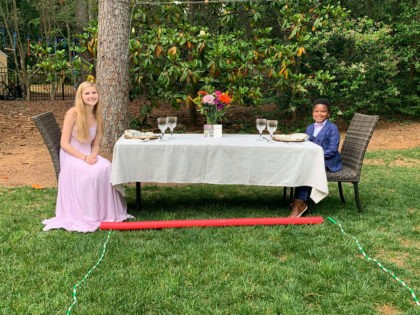 Seven-year-old Curtis Rogers, of Raleigh, North Carolina, created a social distance-style prom for his babysitter on Tuesday.