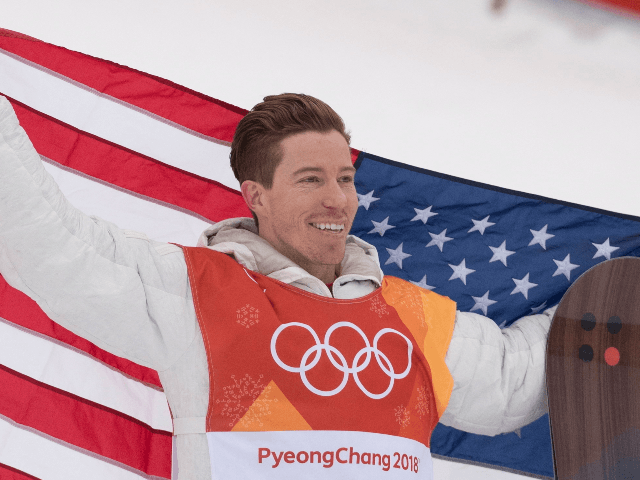 Shaun White, of the United States, celebrates his gold medal win in snowboard halfpipe at the Pyeongchang 2018 Winter Olympic Games in South Korea, Wednesday, Feb. 14, 2018. (Jonathan Hayward/The Canadian Press via AP)