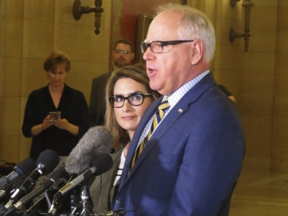 Democratic Minnesota Gov. Tim Walz, right, accompanied by Lt. Gov. Peggy Flanagan, left, speaks with reporters during a break in budget talks at the state Capitol in St. Paul, Minnesota, on Tuesday, May 14, 2019. (AP Photo/Steve Karnowski)