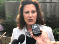 "Gov. Gretchen Whitmer speaks with reporters after inspecting the Elm Street bridge over the Red Cedar River, Monday, Aug. 12, 2019, in Lansing, Mich. Whitmer says it is important that the public knows the seriousness of the state's ""infrastructure crisis."" (AP Photo/David Eggert)"