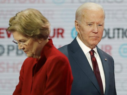 Democratic presidential candidates Sen. Elizabeth Warren, D-Mass., left, and former Vice President Joe Biden stand on stage during a break at a Democratic presidential primary debate Thursday, Dec. 19, 2019, in Los Angeles. (AP Photo/Chris Carlson)