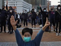 Protesters raise five demands gestures during a rally in Hong Kong, Sunday, Jan. 12, 2020. More than a thousand people attended a Sunday rally in Hong Kong to urge people and governments abroad to support the territory's pro-democracy movement and oppose China's ruling Communist Party. (AP Photo/Vincent Yu)