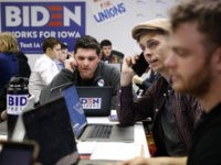 Volunteers call potential caucus-goers at a campaign field office for Democratic presidential candidate former Vice President Joe Biden, Monday, Jan. 13, 2020, in Des Moines, Iowa. (AP Photo/Patrick Semansky)