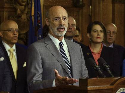 Gov. Tom Wolf speaks at a news conference in his Capitol offices as he unveils a $1.1 billion package intended to help eliminate lead and asbestos contamination in Pennsylvania's schools, homes, day care facilities and public water systems, Wednesday, Jan. 29, 2020 in Harrisburg, Pa. Looking on are Democratic state …