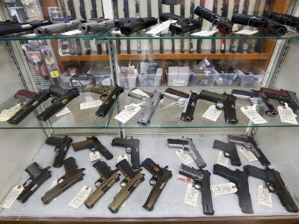 Semi-Automatic handguns are displayed at Duke's Sport Shop, Wednesday, March 25, 2020, in New Castle, Pa. (AP Photo/Keith Srakocic)