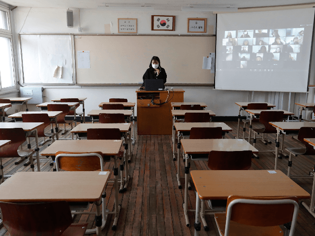 Teacher Lee Gang-in gives an online class to her students amid the new coronavirus outbreak at Seoul girls' high school in Seoul, Thursday, April 9, 2020. Senior high school students begin school semester with online classes. Schools remain closed as part of measures taken by the government to stop the …