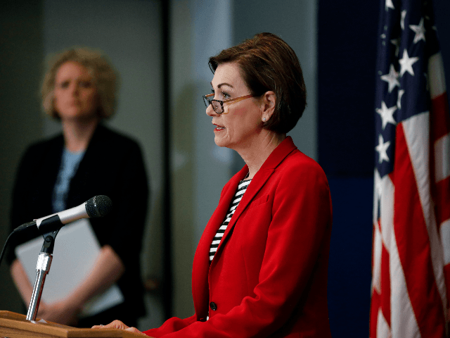 Iowa Gov. Kim Reynolds updates the state's response to the coronavirus outbreak during a news conference at the State Emergency Operations Center, Thursday, April 30, 2020, in Johnston, Iowa. (AP Photo/Charlie Neibergall, Pool)