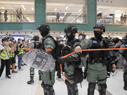 Riot police enter the shopping mall to disperse the protesters during the Labor Day in Hong Kong, Friday, May 1, 2020 amid the coronavirus COVID-19 pandemic. Hong Kong police deployed pepper spray during a protest in a Hong Kong shopping mall on Friday, as they dispersed over a hundred protesters …