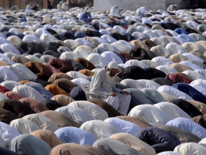 Muslims offer an Eid al-Fitr prayer at a ground in Karachi, Pakistan, Sunday, May 24, 2020. Millions of Muslims across the world are marking a muted and gloomy holiday of Eid al-Fitr, the end of the fasting month of Ramadan - a usually joyous three-day celebration that has been significantly …