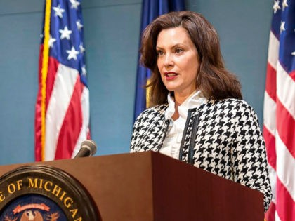 In this photo provided by the Michigan Executive Office of the Governor, Gov. Gretchen Whitmer speaks during a news conference Tuesday, May 26, 2020, in Lansing, Mich. Whitmer announced that people who leave their home for work or those who have coronavirus symptoms can be tested without needing a doctor's …
