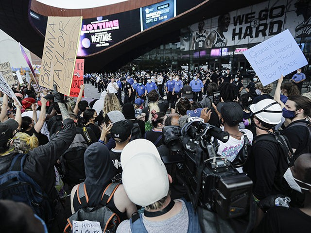 Protesters rally at the Barclays Center over the death of George Floyd, a black man who was in police custody in Minneapolis Friday, May 29, 2020, in the Brooklyn borough of New York. Floyd died after being restrained by Minneapolis police officers on Memorial Day. (AP Photo/Frank Franklin II)