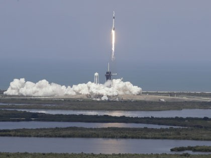 The SpaceX Falcon 9 and the Crew Dragon capsule, with NASA astronauts Bob Behnken and Doug Hurley onboard, lifts off Saturday, May 30, 2020, at the Kennedy Space Center in Cape Canaveral, Fla. (AP Photo/Chris O'Meara)