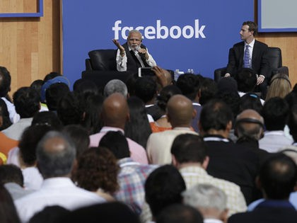 Prime Minister of India Narendra Modi, left, speaks next to Facebook CEO Mark Zuckerberg at Facebook in Menlo Park, Calif., Sunday, Sept. 27, 2015. A rare visit by Indian Prime Minister Narendra Modi this weekend has captivated his extensive fan club in the area and commanded the attention of major …