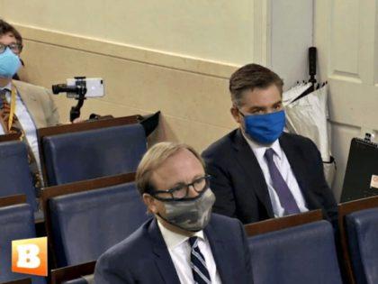 Accosta and Karl Wear Masks