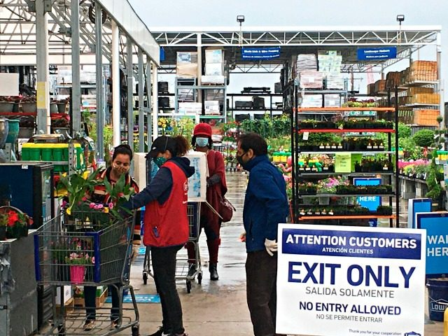 Customers get checked out from the garden center at a Lowe's store in Harrisburg, Pa., Wednesday, May 6, 2020. As swaths of Pennsylvania prepare for a limited reopening Friday, some fed-up business owners are jumping the gun and have resumed serving customers in defiance of Gov. Tom Wolf's shutdown order. …