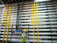 A worker walks at the new desalination plant in the city of Hadera, Israel, Sunday, May 16, 2010. Israel on Sunday dedicated a water desalination plant designed to help alleviate the country's chronic water shortage. The plant, on the mediterranean coast south of the port city of Haifa, is the …