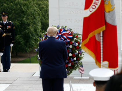 President Donald Trump stands before a wreath at the Tomb of the Unknown Soldier in Arlington National Cemetery, in honor of Memorial Day, Monday, May 25, 2020, in Arlington, Va. (AP Photo/Alex Brandon)