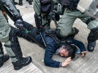 HONG KONG - AUGUST 24: A protester is detained by riot police during an anti-government rally in Kowloon Bay district on August 24, 2019 in Hong Kong, China. Pro-democracy protesters have continued rallies on the streets of Hong Kong against a controversial extradition bill since 9 June as the city …