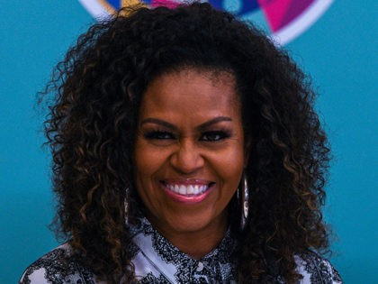 Former US first lady Michelle Obama (C) smiles as she attends a side event for the Obama Foundation in Kuala Lumpur on December 12, 2019. (Photo by Mohd RASFAN / AFP) (Photo by MOHD RASFAN/AFP via Getty Images)