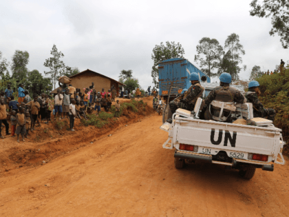 In this photograph taken on March 13, 2020, Moroccan soldiers from the UN mission in DRC (Monusco) ride in a vehicle as they patrol in the violence-torn Djugu territory, Ituri province, eastern DRCongo. - Fresh violences have been registered against civilians in this territory where more than 700 hundreds have …