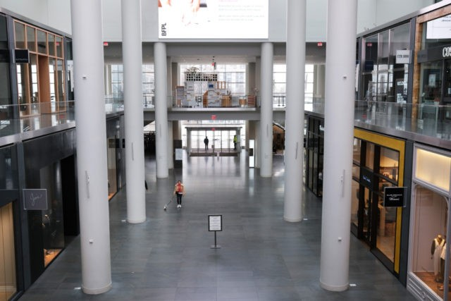 NEW YORK CITY, NY - MARCH 29: People walk through an empty Brookfield Place mall in lower Manhattan on March 29, 2020 in New York City. Across the country schools, businesses and places of work have either been shut down or are restricting hours of operation as health officials try …