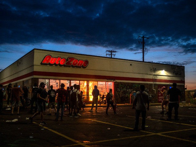 MINNEAPOLIS, MN - MAY 27: A fire burns inside of an Auto Zone store near the 3rd Police Precinct on May 27, 2020 in Minneapolis, Minnesota. Businesses near the station were looted and damaged today as the area has become the site of an ongoing protest after the police killing …