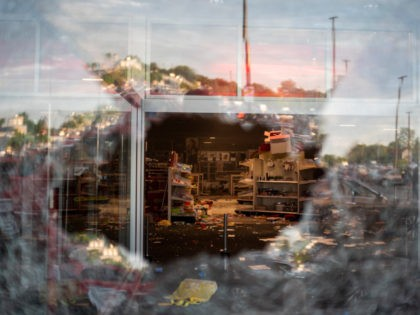 MINNEAPOLIS, MN - MAY 27: A view inside a Target store through a broken window on May 27, 2020 in Minneapolis, Minnesota. Businesses near the 3rd Police Precinct were looted and damaged today as the area has become the site of an ongoing protest after the police killing of George …