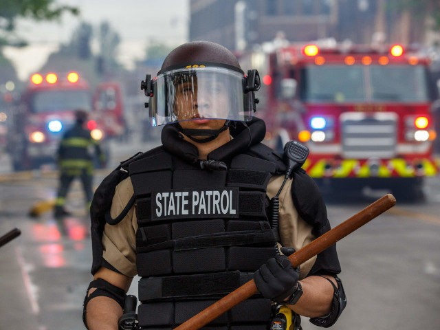 State Patrol Police officers block a road on the fourth day of protests on May 29, 2020 in Minneapolis, Minnesota. Protesters demand justice for George Floyd who died in police custody. - Five hundred National Guard soldiers and airmen have been deployed in the northern US cities of Minnesota and …