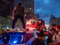 NEW YORK, NEW YORK - MAY 30: Protestors vandalize a police cruiser in Union Square on May 30, 2020 in New York City. Minneapolis Police officer Derek Chauvin was filmed kneeling on Floyd's neck. Floyd was later pronounced dead at a local hospital. Across the country, protests against Floyd's death …