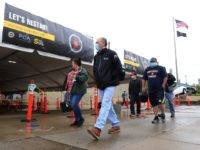 United Auto Workers members leave the Fiat Chrysler Automobiles Warren Truck Plant after the first work shift on May 18, 2020 in Warren, Michigan. Fiat Chrysler along with rivals Ford and General Motors Co., restarted the assembly lines on Monday after several week of inactivity due to the COVID-19 pandemic. …