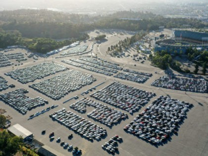 LOS ANGELES, CALIFORNIA - MAY 20: An aerial view of stationed rental cars parked at Dodger Stadium amid the coronavirus pandemic on May 20, 2020 in Los Angeles, California. With Major League Baseball's season delayed due to COVID-19 and rental cars in short demand with most travel curtailed, rental car …