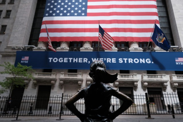 NEW YORK, NEW YORK - MAY 26: The New York Stock Exchange (NYSE) stands in lower Manhattan on the first day that traders are allowed back onto the historic floor of the exchange on May 26, 2020 in New York City. While only a small number of traders will be …