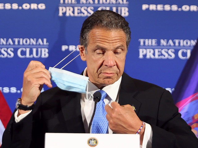 WASHINGTON, DC - MAY 2: New York Governor Andrew Cuomo removes his face mask at the start of a news conference at the National Press Club May 27, 2020 in Washington, DC. Following a closed-door meeting with President Donald Trump at the White House, Cuomo leveled criticism at Republican senators …