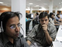 "MOHALI, INDIA: TO GO WITH ""INDIA-IT-OUTSOURCING"" Indian employees of the Quark call center work during their night shift, late 09 May 2005 in Mohali, in India's northern state of Punjab. Bangalore may be better known to people outside of India as the place where customer calls from around the world …"
