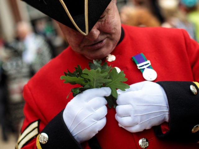 LONDON, ENGLAND - JUNE 07: A Chelsea Pensioner attaches oak leaves to his uniform ahead of the Founder's Day Parade at Royal Hospital Chelsea on June 7, 2018 in London, England. The annual event celebrates the founding of the Royal Hospital Chelsea by King Charles II in 1681. The hospital …