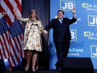 Democratic candidate for governor J.B. Pritzker waves to supporters as he enters the stage with wife M.K. to claim victory in Chicago, Tuesday, Nov. 6, 2018. (AP Photo/Nam Y. Huh)