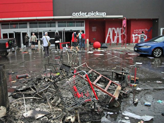 Debris and carts are strewn in the Target parking lot near the Minneapolis Police Third Precinct, Thursday, May 28, 2020, following a night of rioting and looting as protests continue over the arrest of George Floyd who died in police custody. Floyd died after being restrained by Minneapolis police officers …
