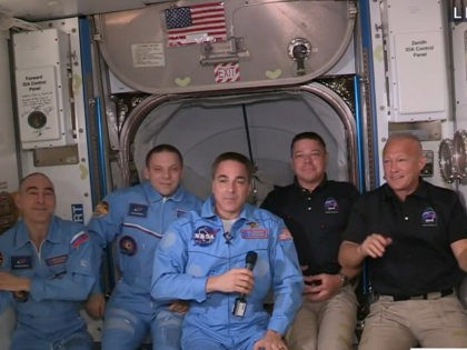 NASA's feed, NASA astronauts Doug Hurley (R) and Bob Behnken (2R) join NASA astronaut Chris Cassidy (C) and Russian cosmonauts, Anatoly Ivanishin (L) and Ivan Vagner (2L) aboard the International Space Station after successfully docking SpaceX's Dragon capsule May 31, 2020.