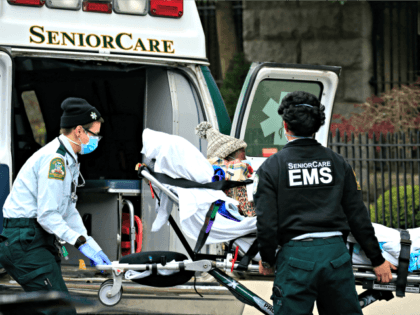 NEW YORK, NEW YORK - APRIL 18: Emergency Medical Service workers unload a patient out of their ambulance at the Cobble Hill Health Center on April 18, 2020 in the Cobble Hill neighborhood of the Brooklyn borough of New York City. The nursing home has had at least 55 COVID-19 …