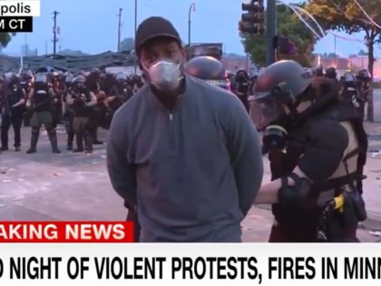 "CNN ""New Day"" on Friday morning cut to correspondent Omar Jimenez as he reported on the scene in Minneapolis after protests turned violent. During the middle of the broadcast, Jimenez and his crew of a cameraman and a producer were all arrested by Minnesota State Patrol."