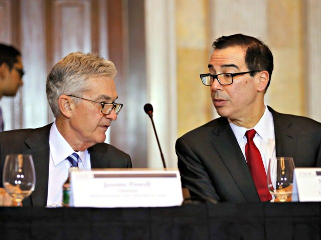 Treasury Secretary Steve Mnuchin right speaks with Federal Reserve Chairman Jerome Powell at the start of a meeting of the Financial Stability Oversight Council Tuesday Oct. 16 2018 at the Treasury Department in Washington. (AP