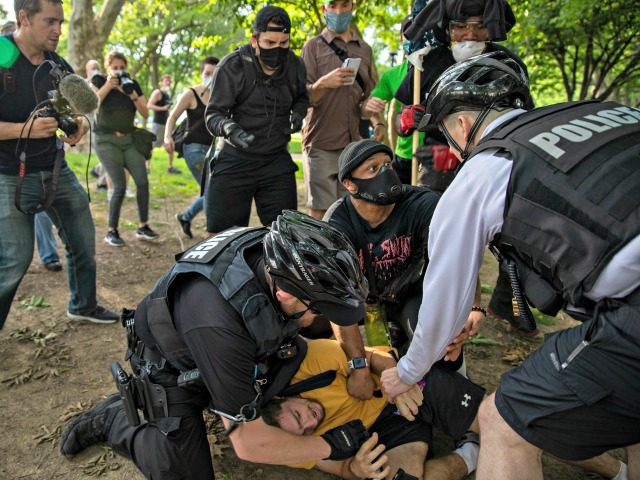 WASHINGTON, DC - MAY 29: Demonstrators clash with police during a protest in response to the police killing of George Floyd in Lafayette Square Park on May 29, 2020 in Washington, DC. Across country, protests against Floyd's death have set off days and nights of rage as the most recent …