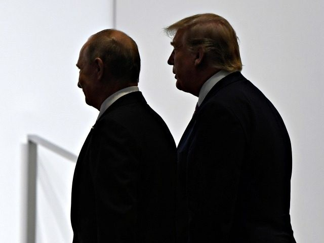 FILE - In this June 28, 2019, file photo, President Donald Trump and Russian President Vladimir Putin walk to participate in a group photo at the G20 summit in Osaka, Japan. The Trump administration is notifying international partners that it is pulling out of a treaty that permits 30-plus nations …