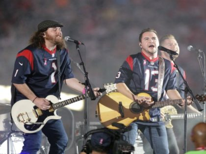 FILE - This Oct. 9, 2014 file photo shows The Eli Young Band performing during halftime of an NFL football game in Houston. The band will perform as part of the Concert in Your Car series at the new Texas Rangers stadium ,Globe Life Field, in Arlington, Texas starting June …