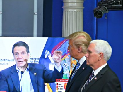 WASHINGTON, DC - APRIL 19: U.S. President Donald Trump and Vice President Mike Pence watch a TV clip of New York state Gov. Andrew Cuomo at the daily coronavirus briefing at the White House on April 19, 2020 in Washington, DC. New York state will begin the nation's most aggressive …