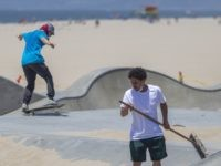 LOS ANGELES, CA - MAY 24: Skateboarders remove sand that was dumped into a skate park to keep them out during stay-at-home restrictions at Venice Beach on Memorial Day as coronavirus safety restrictions continue being relaxed in Los Angeles County and nationwide on May 24, 2020 in Los Angeles, California. …
