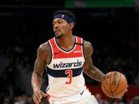 Washington Wizards guard Bradley Beal (3) dribbles the ball during the second half of an NBA basketball game against the Miami Heat, Sunday, March 8, 2020, in Washington. The Heat won 100-89. (AP Photo/Nick Wass)