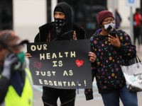 NEW YORK, NEW YORK - MARCH 30: Amazon employees hold a protest and walkout over conditions at the company's Staten Island distribution facility on March 30, 2020 in New York City. Workers at the facility, which has had numerous employees test positive for the coronavirus, want to call attention to …